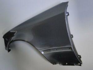 MERCEDES E KLASA W124 BŁOTNIK LEWY PRZEDNI AMG 500